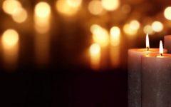 various lit candles dark background